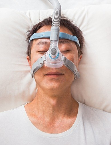 Woman with CPAP nasal mask