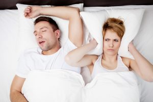 Sleep center in Las Vegas discusses the difference between snoring and sleep apnea.