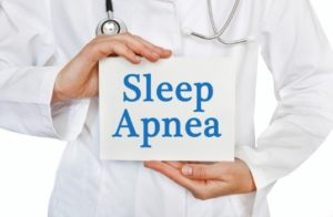 Doctor holding sleep apnea sign