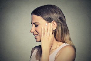 woman with jaw and ear pain