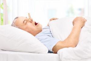 older man snoring