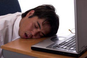 man asleep at desk mouth open
