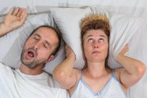 man sleeping snoring woman upset