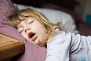 Child sleeping with her mouth open
