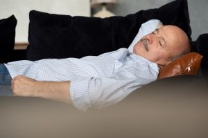 Sleeping man, unconcerned about relationship between napping and sleep apnea